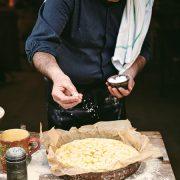 Gennaro's Italian Bakery: salting focaccia