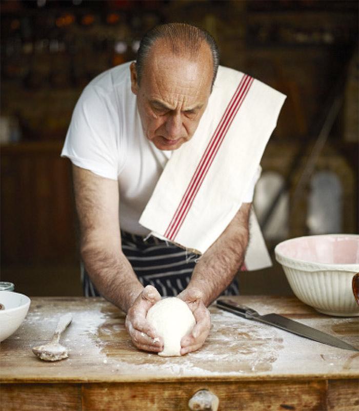 Gennaro preparing pizza dough